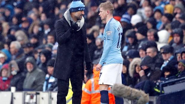 Pep-Guardiola-Kevin-De-Bruyne-Manchester-City-min