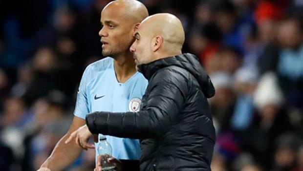 Pep-Guardiola-and-Vincent-Kompany-Man-City-min