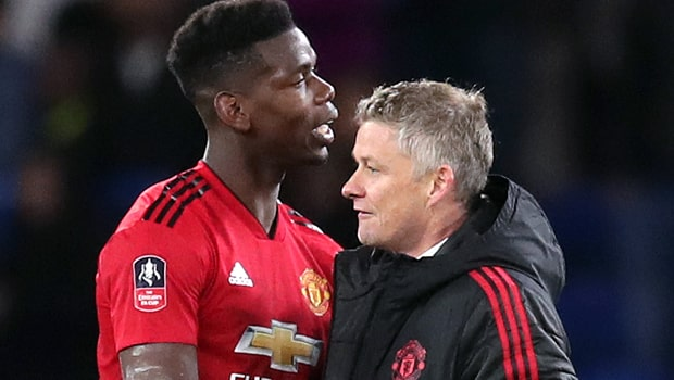 Ole-Gunnar-Solskjaer-and-Paul-Pogba-Man-United-min