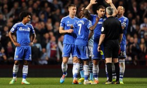Chelsea team with referee Chris Foy