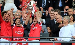 Mikel Arteta Arsenal celebrate with the FA Cup trophy