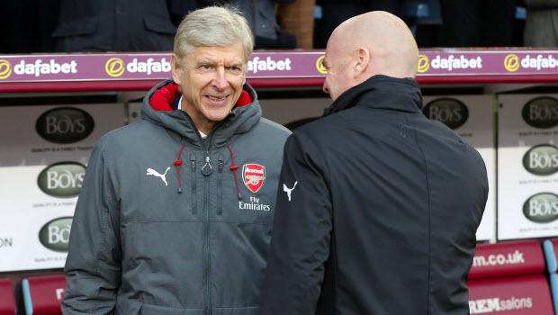 Arsenal manager Arsene Wenger (left) and Burnley manager Sean Dyche