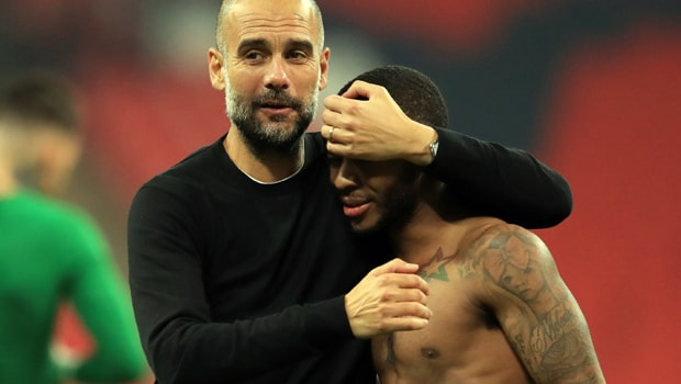 Pep-Guardiola-and-Raheem-Sterling-Man-City-min