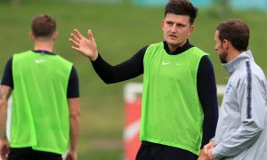 Harry-Maguire-and-Gareth-Southgate-England-min
