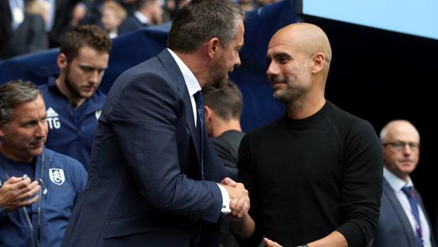 Pep-Guardiola-Manchester-City-coach-min